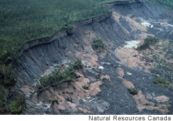 Part of the MacKenzie River bank collapses as the underlying permafrost melts